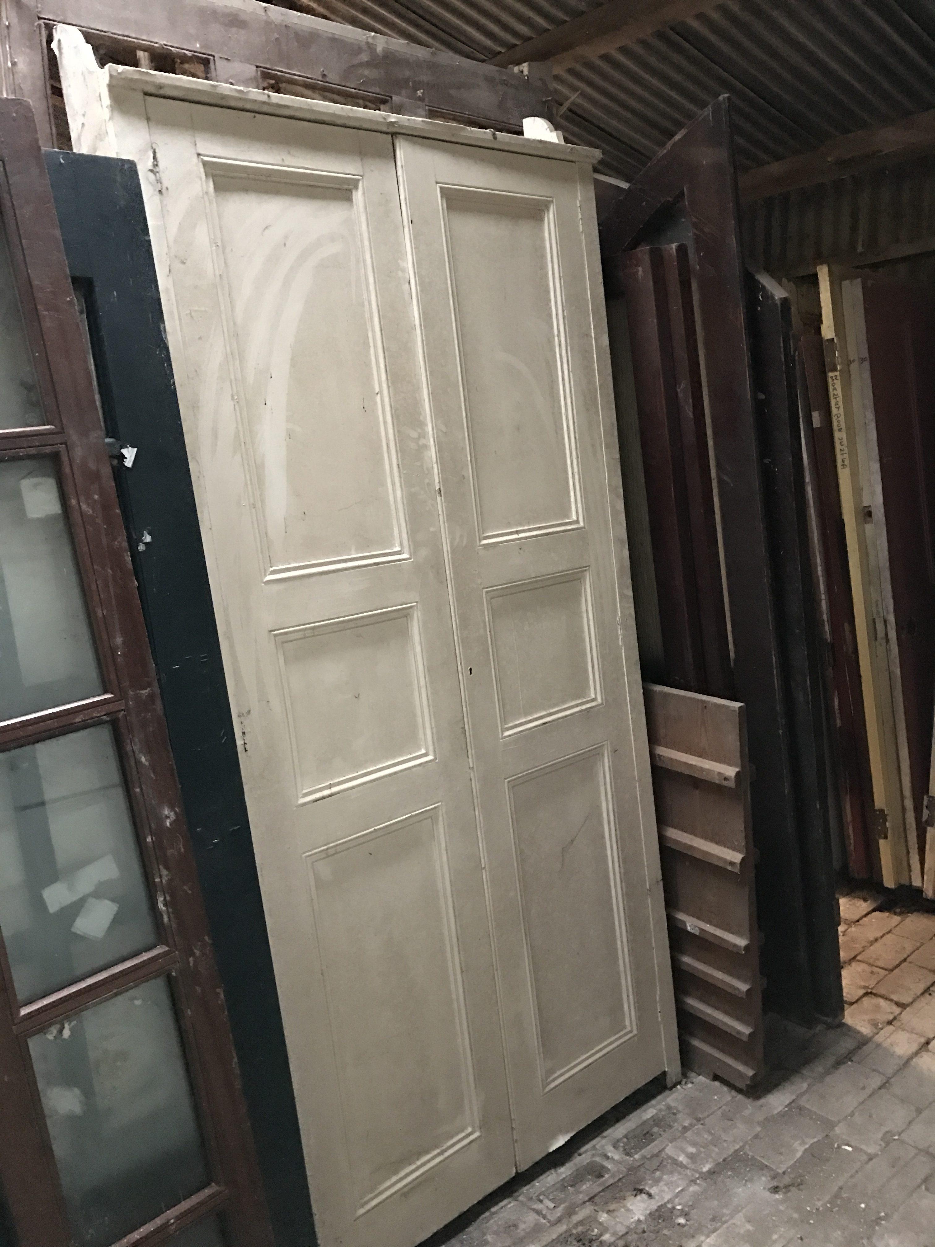 Pair of opening pannelled doors. 107cm x 215/230cm. 18cm deep.